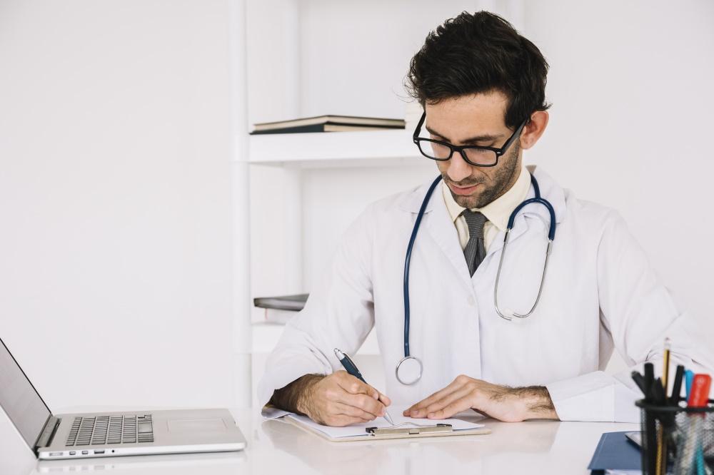 Doctor prescripting medicines