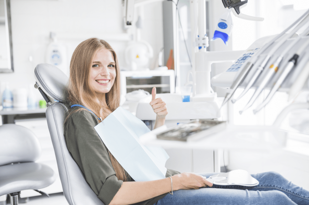 oung woman feeling releaved at the dentist΄s